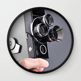 Retro hobbies movie camera in hands Wall Clock