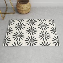 Black snowflake on light beige pattern Rug