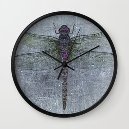 Dragonfly on blue stone and metal background Wall Clock