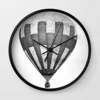 hot air balloon Wall Clocks featuring Hot Air Balloon by Rose Etiennette