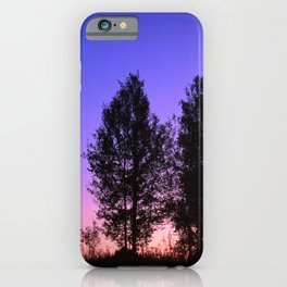 Nightfall. Purple and pink sky in the forest after sunset. iPhone Case