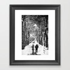 Couple on snowy street Framed Art Print