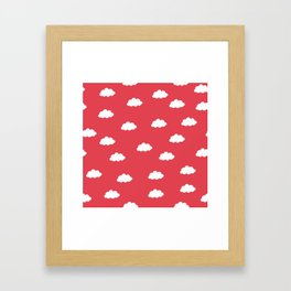 White clouds in red background Framed Art Print
