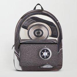 Retro mechanical hobbies movie camera in hand Backpack