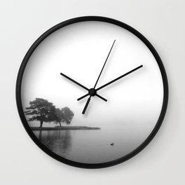 Duck swimming the foggy lake Wall Clock