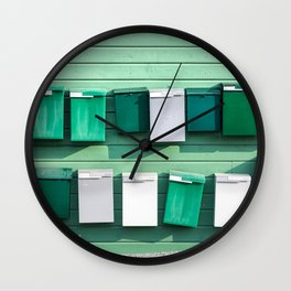 Group of small post boxes on a wooden wall. Wall Clock