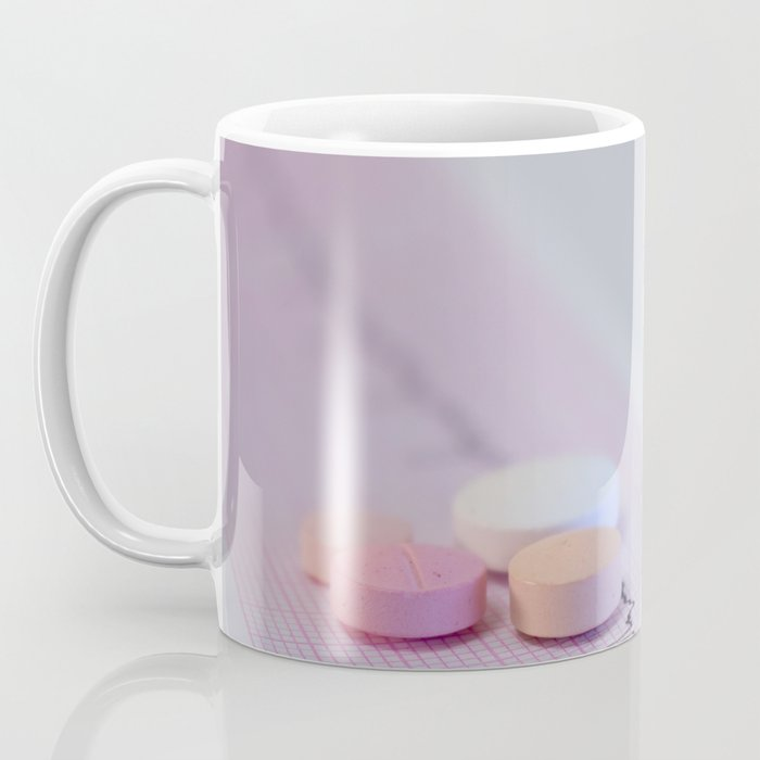 Some colored tablets on an electrocardiogram strip Coffee Mug