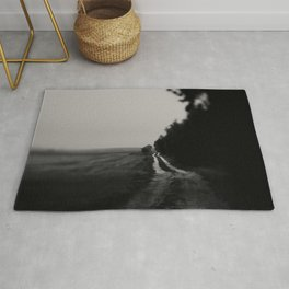 black and white dirt track photograph Rug