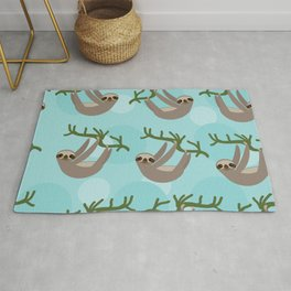 Three-toed sloth on green branch blue background Rug
