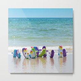 Penguins on the beach Metal Print