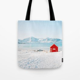 Red cabin on the beach with snow in the Lofoten Islands, Norway Tote Bag