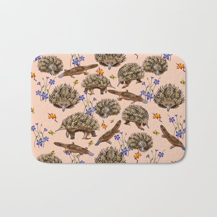 monotremes and wildflowers on apricot Bath Mat