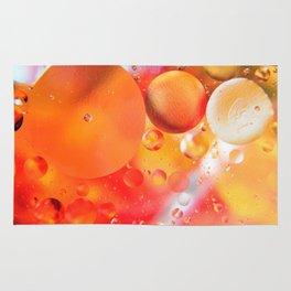Bubbles in orange background Rug