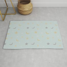 Gold and silver moon and star pattern on light blue background Rug