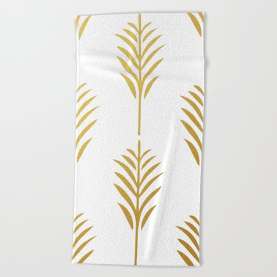 Golden Palm Leaves on White Beach Towel