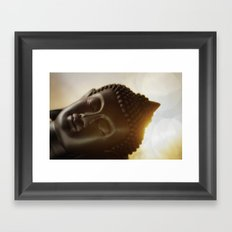 The silhouette of a Buddha head in Sunrise Framed Art Print