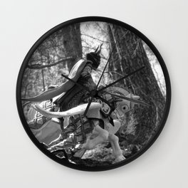 Knight riding through the forest Wall Clock