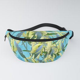 Beautiful Australian Wattle blooms against a textured blue background Fanny Pack