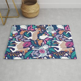 Spring Joy // navy blue background pale blue lambs and brown taupe donkeys blue mint and pink garden Rug