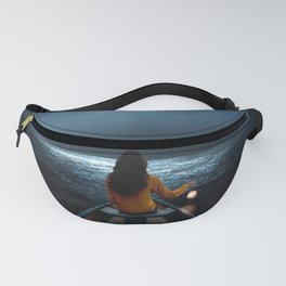 Woman in a boat in the ocean at night-Lantern Lights Fanny Pack