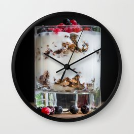 Granola with yogurt and berries in a glass macro with dark background Wall Clock
