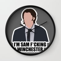 sam winchester Wall Clocks featuring Sam F*cking Winchester by SuperSamWallace
