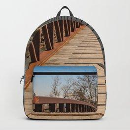 Foot bridge and shadows Backpack