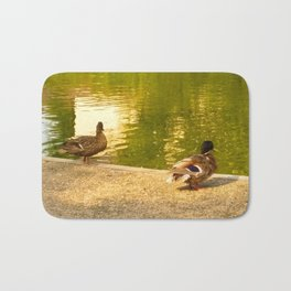 Ducks by the water Bath Mat