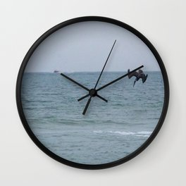 Diving for fish Wall Clock