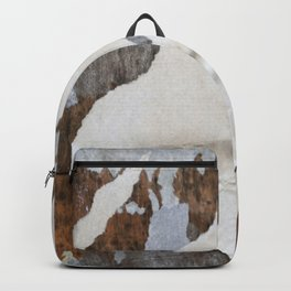 rusty orange wall with poster shreds Backpack