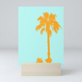 Orange palm trees silhouettes on blue Mini Art Print