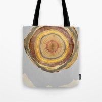 tree rings Tote Bags featuring Tree Rings by Rachael Shankman