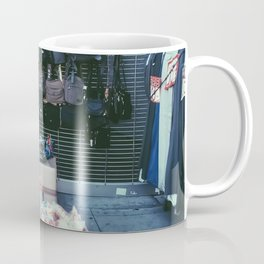 backpack and toy shop on the footpath Coffee Mug