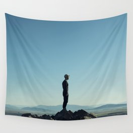 Alone in the blue summit Wall Tapestry