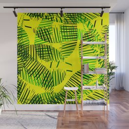 Pattern of green feathers and leaves on a yellow background. Wall Mural