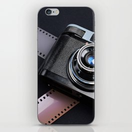 Vintage camera and films on black iPhone Skin