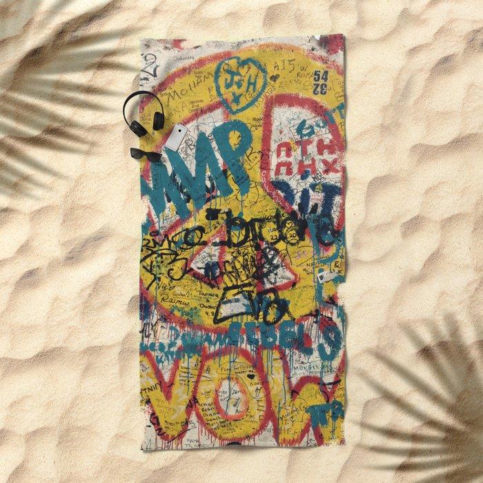 the Berlin wall Beach Towel