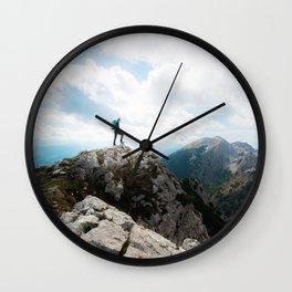 Looking over new adventures Wall Clock