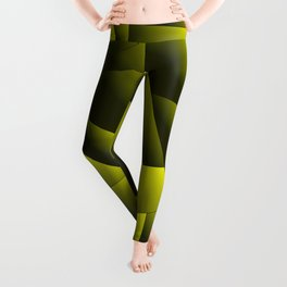 Dark overlapping sheets of yellow paper triangles. Leggings