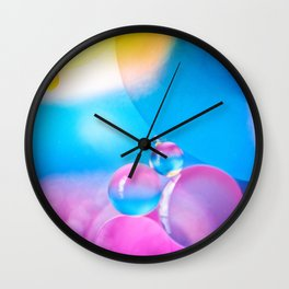 the only wealth is life Wall Clock