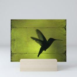 Neon Green Hummingbird behind the Blinds by CheyAnne Sexton Mini Art Print