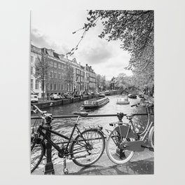 Bicycles parked on bridge over Amsterdam canal Poster