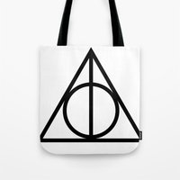 deathly hallows Tote Bags featuring Deathly Hallows symbol by Vera