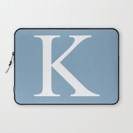 Letter K sign on placid blue background Laptop Sleeve