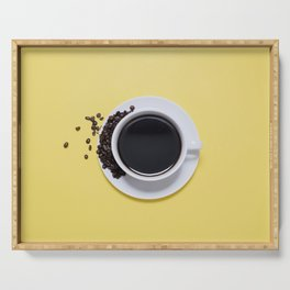 Black Cup of Coffee with Coffee Beans on Yellow Serving Tray