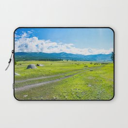Alpine steppe in the background of snowy mountains. Samakh steppe, Altai Mountains, Russia. Laptop Sleeve