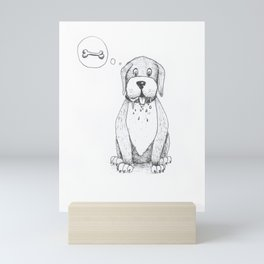 Cute dog dreaming about food Mini Art Print