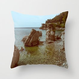 A coastline and a castle Throw Pillow