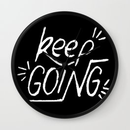 Keep going hand lettering on a black chalkboard . Motivation quote. Wall Clock