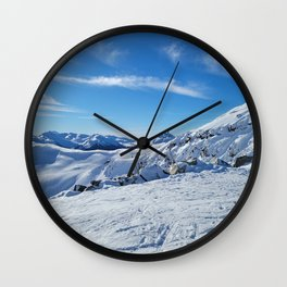 Play of light on mountains snow Wall Clock